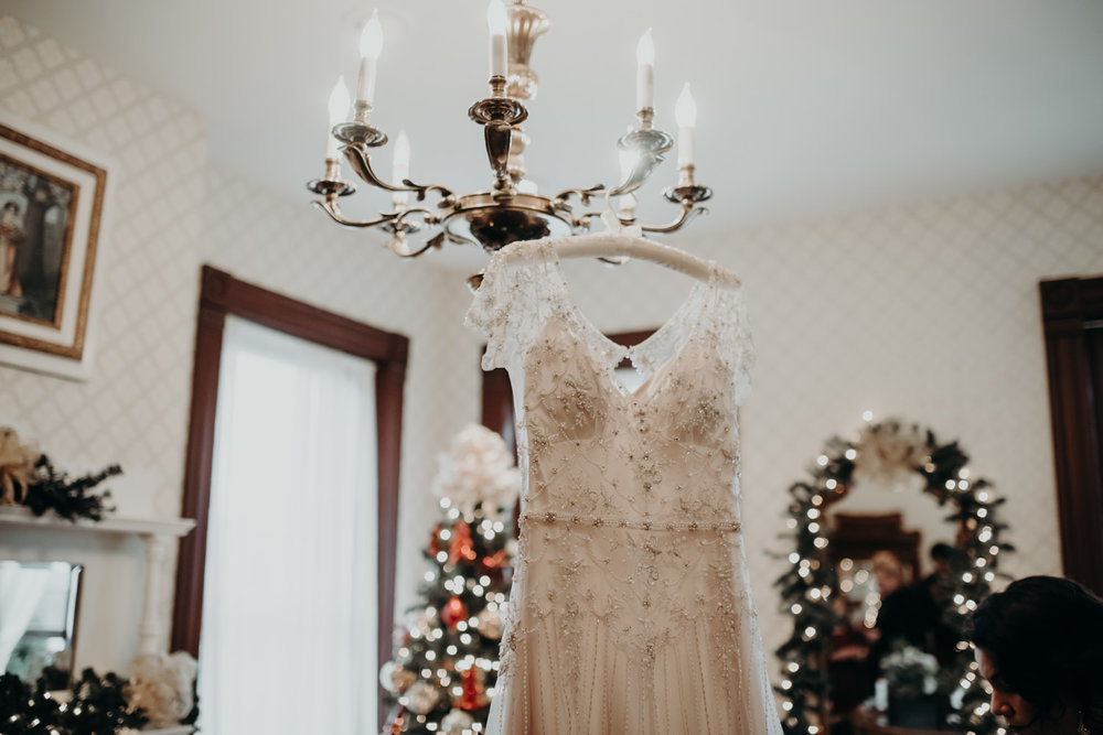 wedding dress hanging from chandelier