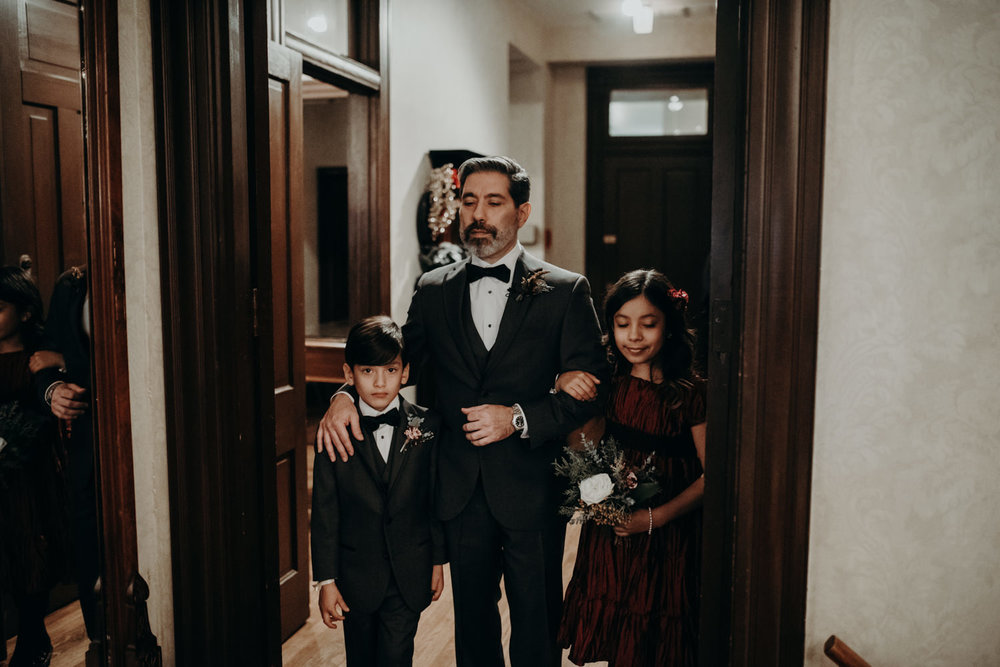 groom and children walk down the aisle