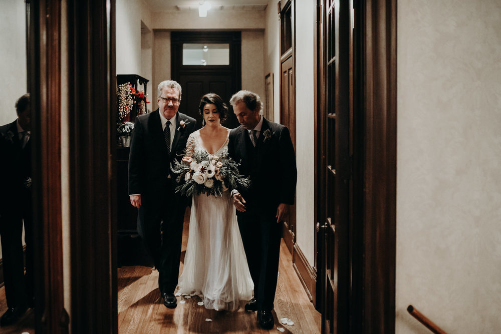 bride walked down the aisle in victorian home wedding