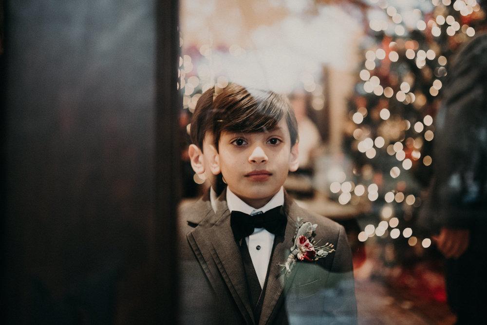 boy in vera wang tux at wedding