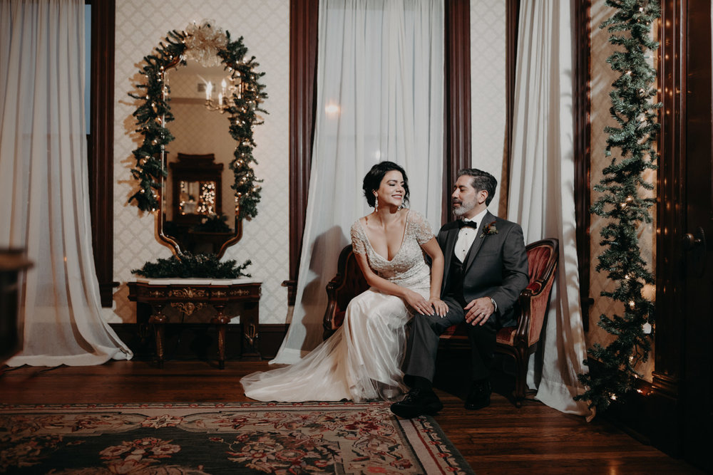 wedding portraits on antique sofa in victorian home