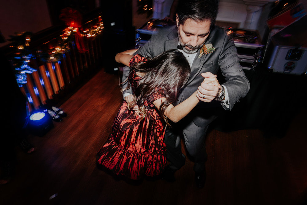 groom and daughter dance at wedding
