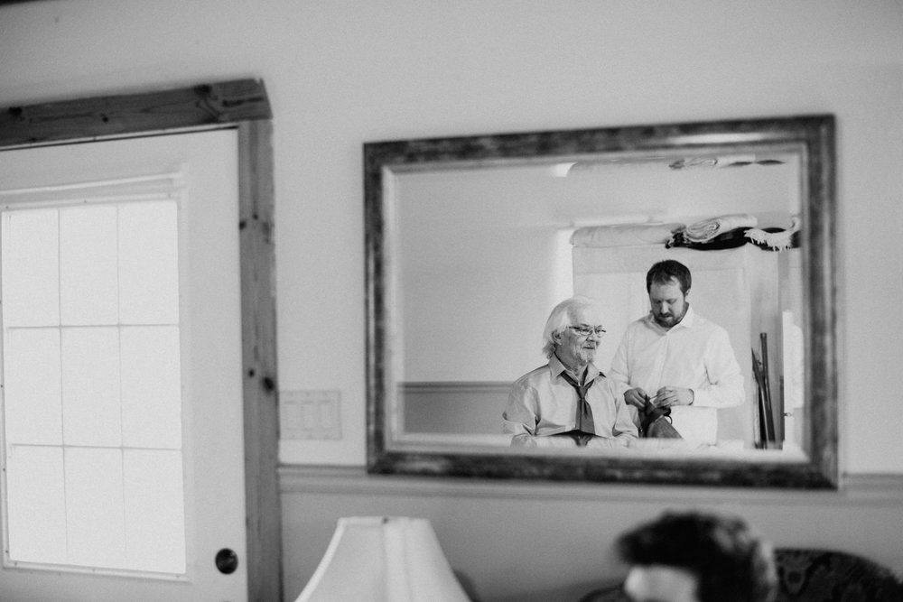 brides father gets ready before wedding