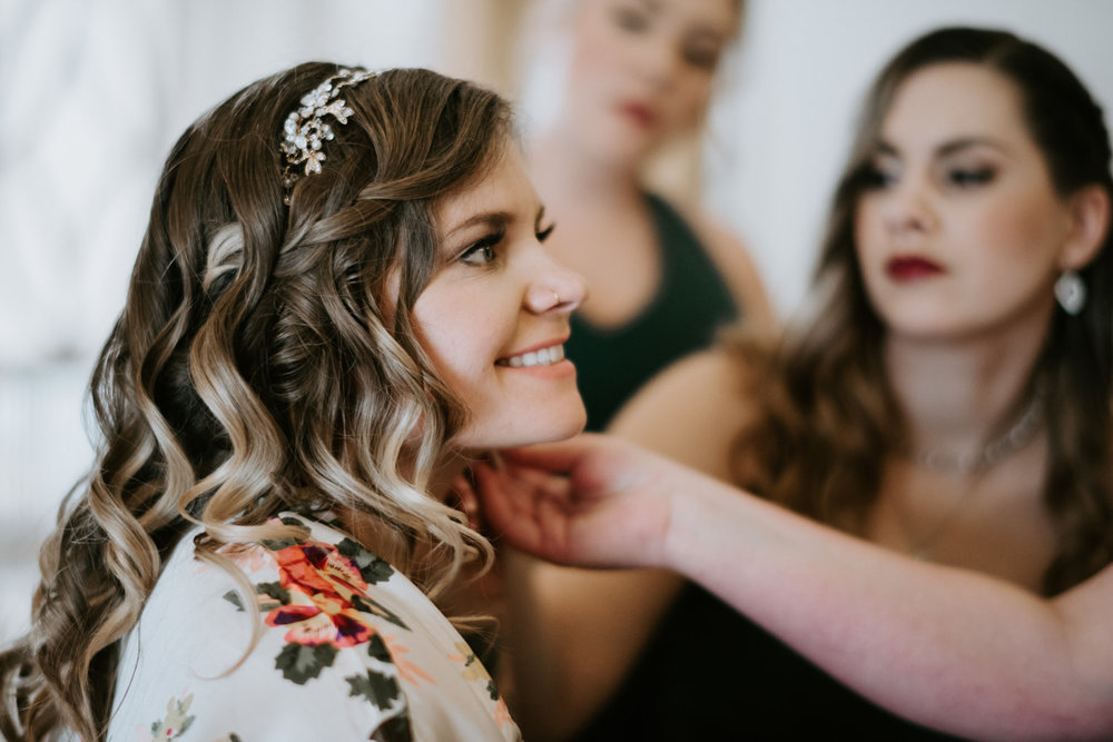 bridesmaids help bride get ready