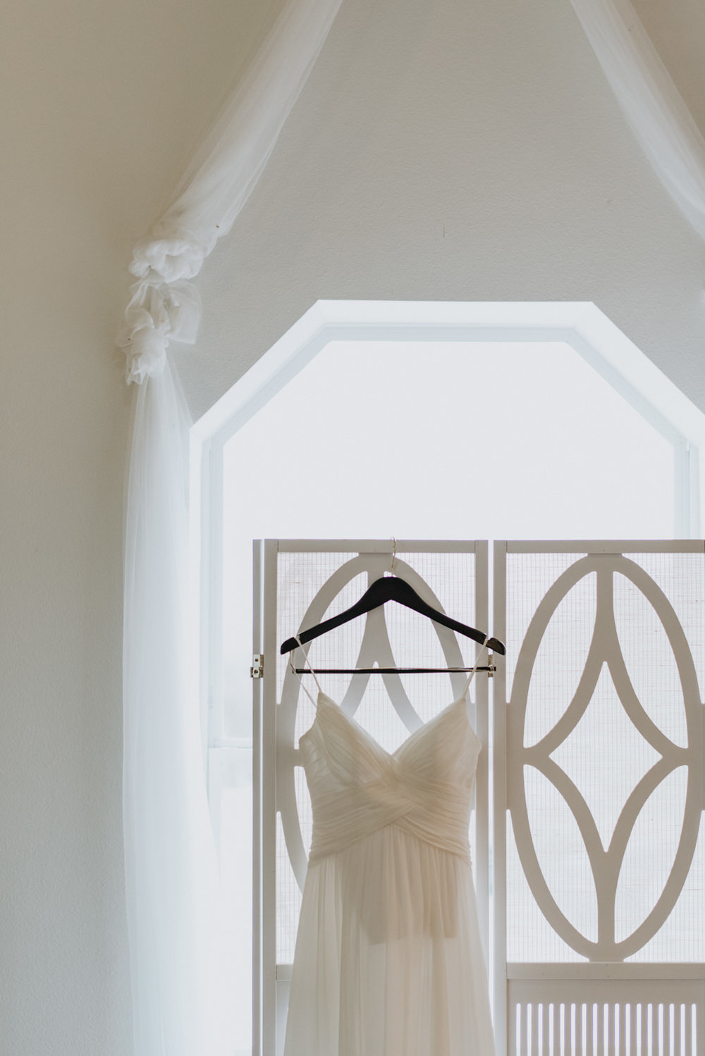 wedding dress hanging in bridal suite at TerrAdorna