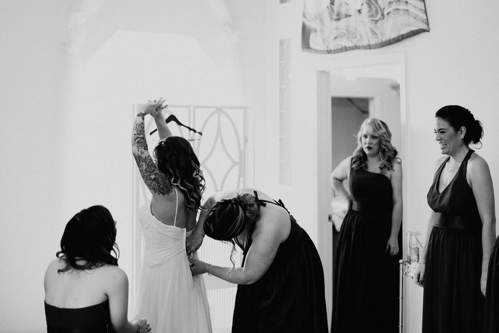 bride putting on her dress at Terradorna wedding