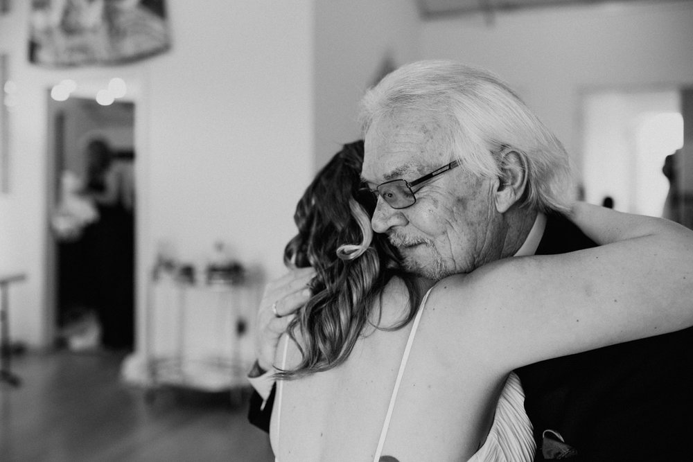 father and daughter hugging before wedding