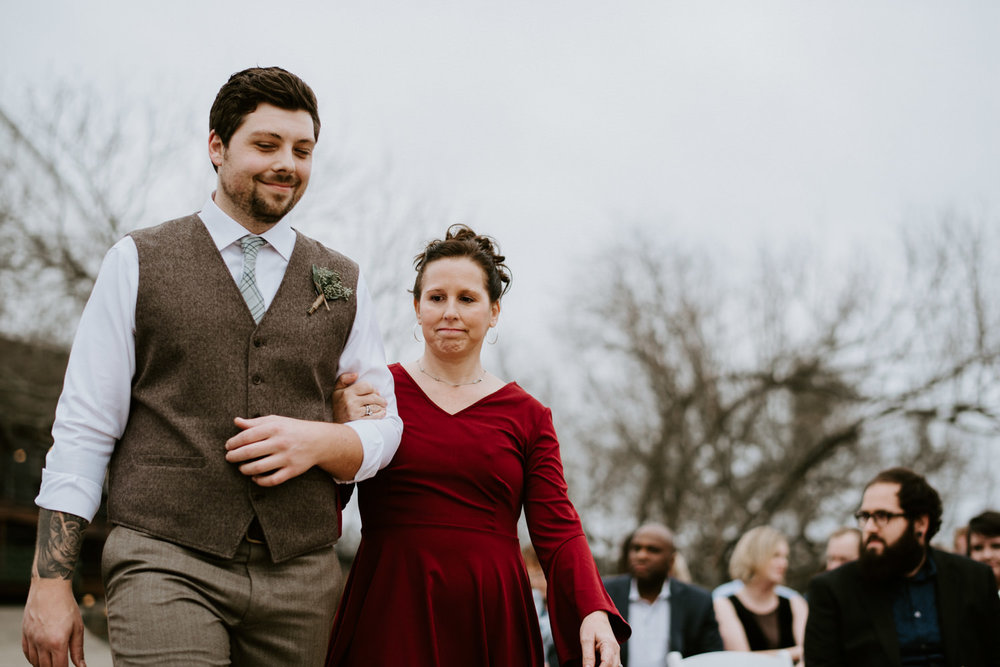 a groom walks his mom down the aisle at Austin wedding