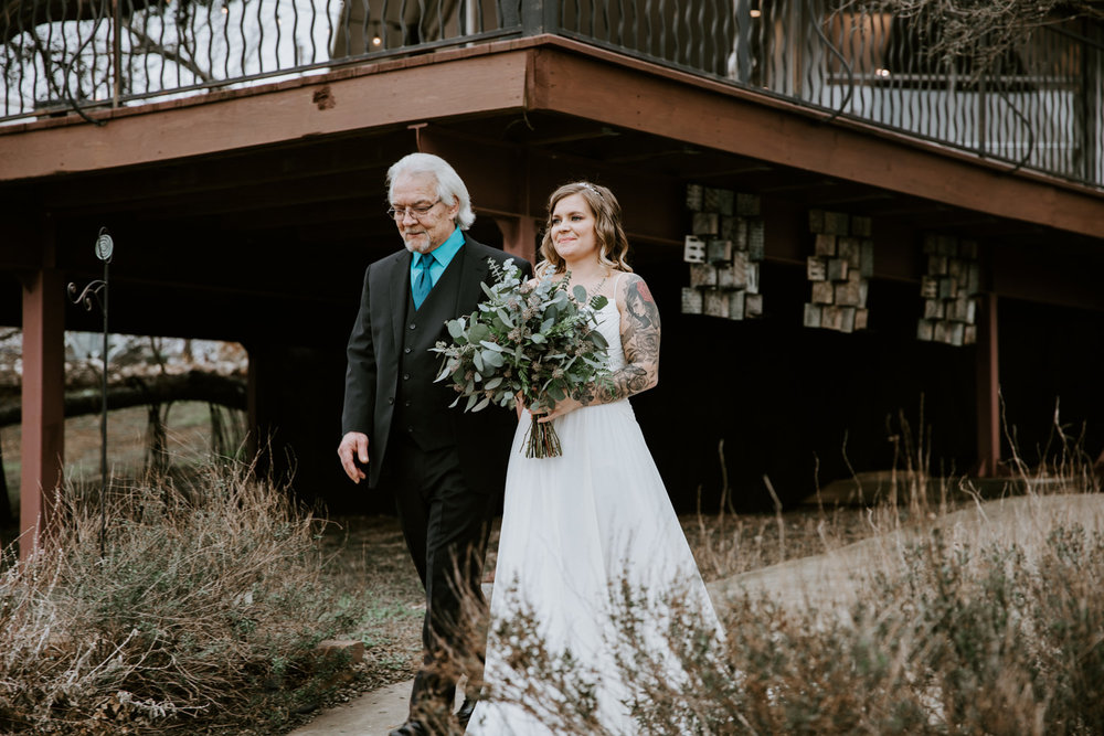 Bride and father walk down the aisle at Austin Texas wedding