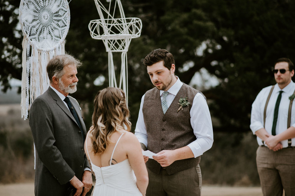 Groom reads his vows at Austin Texas wedding