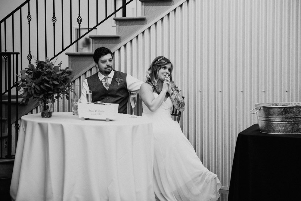 bride listens to emotional speech at her wedding