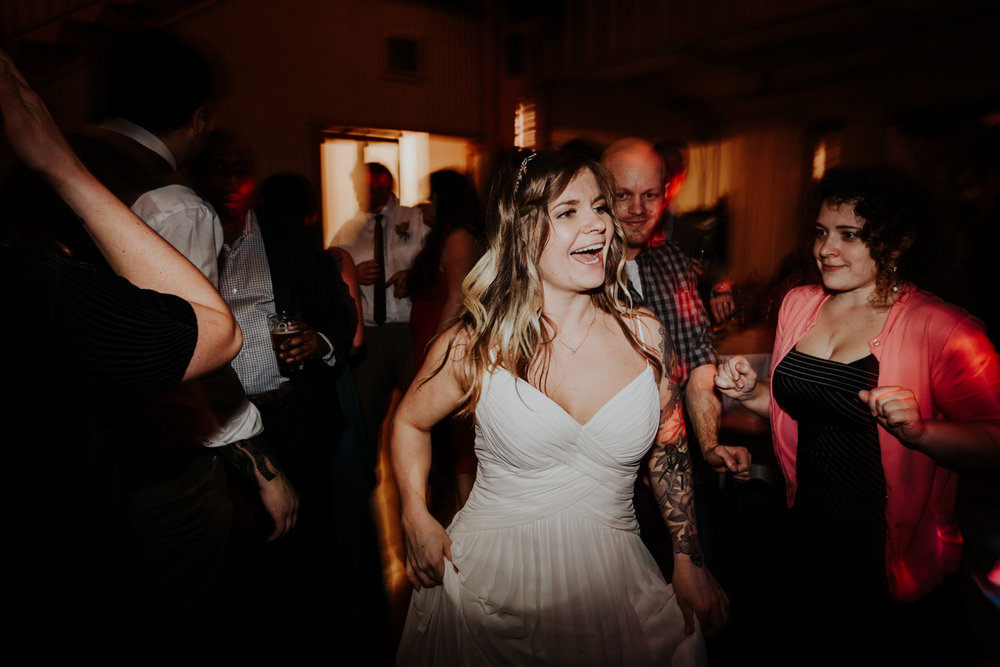 bride has fun at her wedding