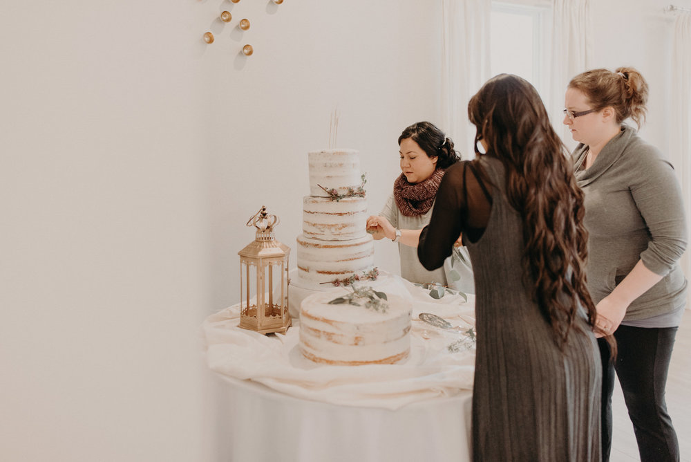 wedding cake being decorated