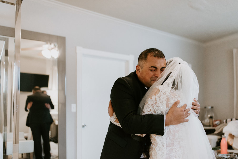 bride and father have an emotional first look