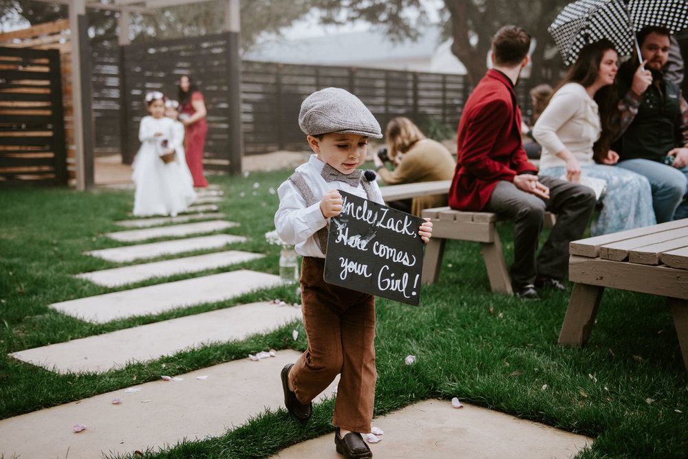 ring bearer in news boy suit