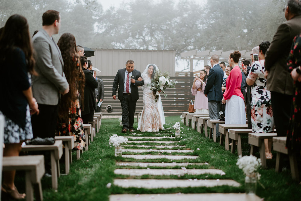 bride walks down the aisle at texas hill country wedding