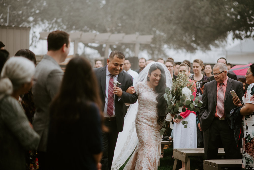 bride walks down the aisle at stonehouse villa wedding ceremony