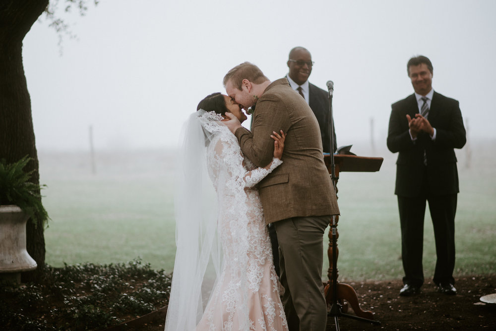 bride and groom kiss at stonehouse villa wedding ceremony
