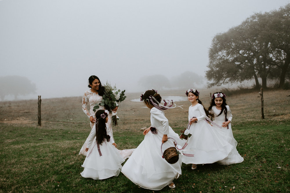 bride and flower girls dancing