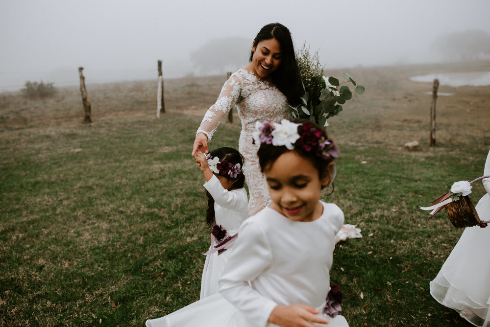 bride and flower girls dancing at austin wedding