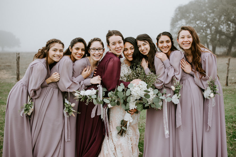 bride and bridesmaids formal portrait at austin wedding