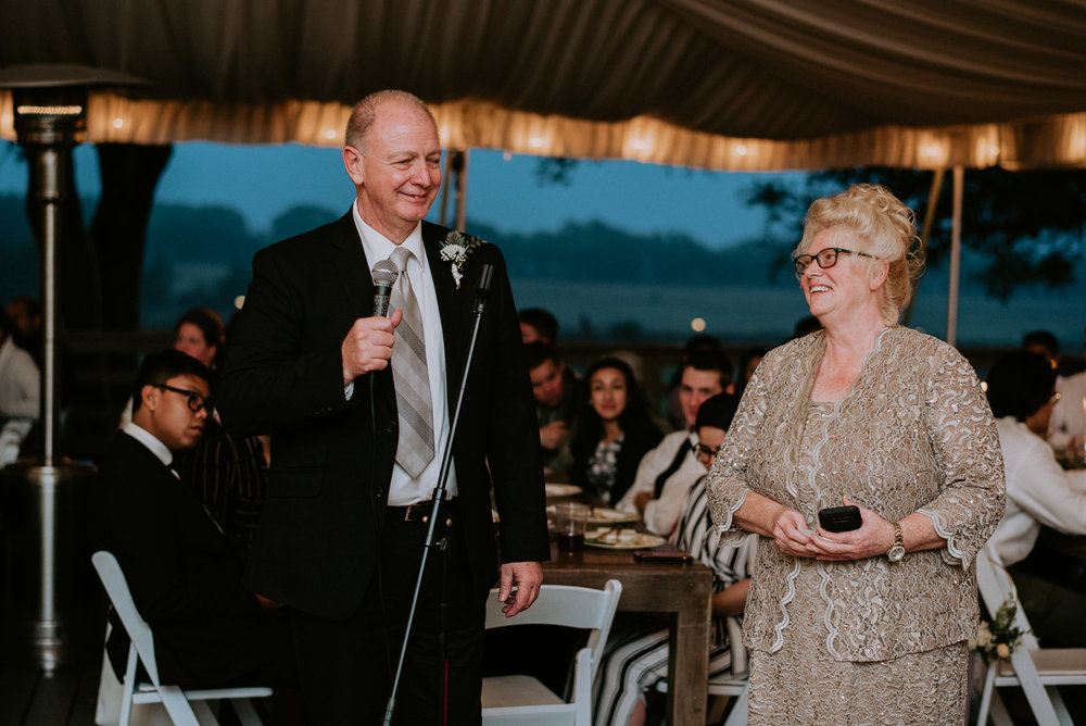father of groom gives wedding reception speech in austin
