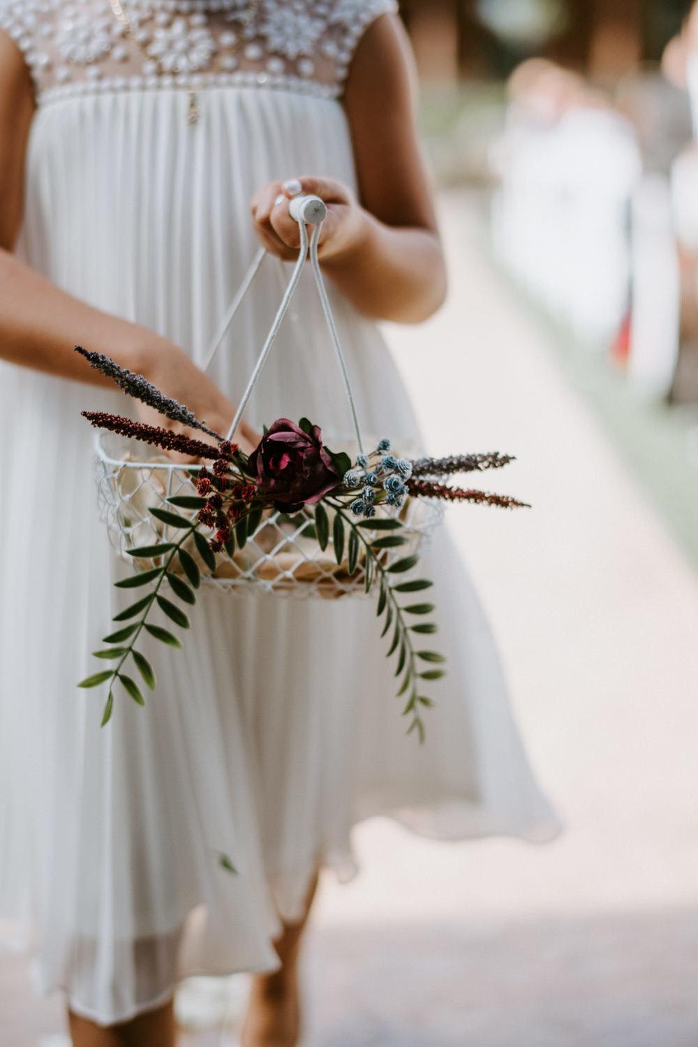flower girl walks down the aisle at houston wedding