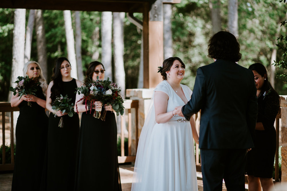 bride and groom hold hands at the springs event venue