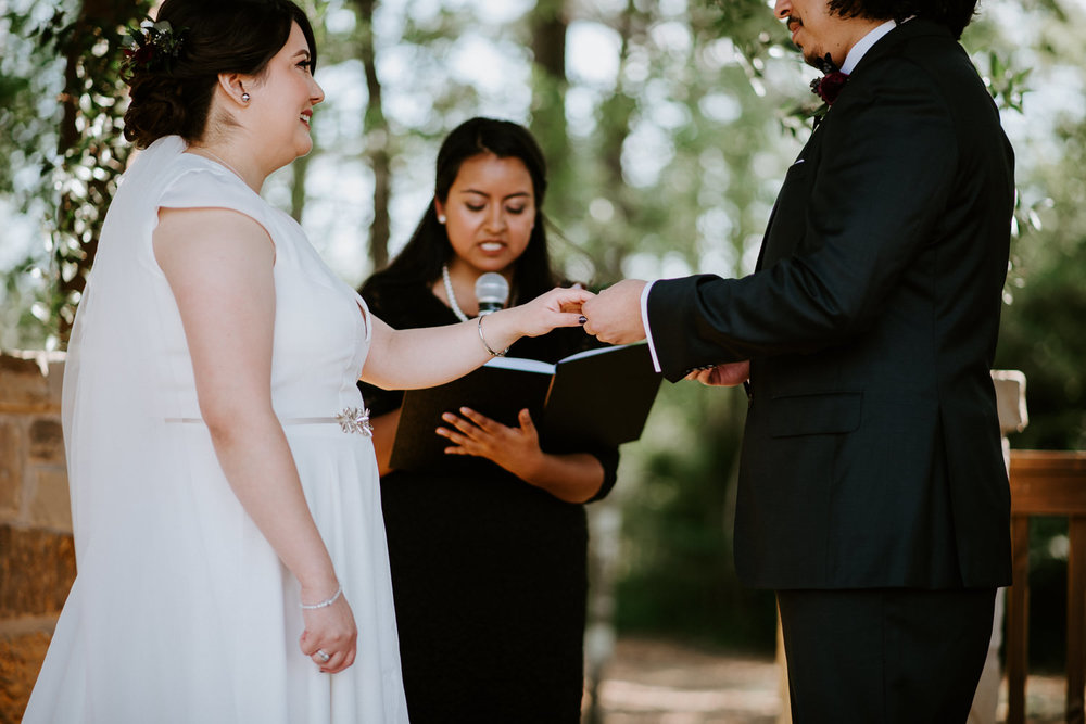 bride and groom exchange rings at houston area wedding