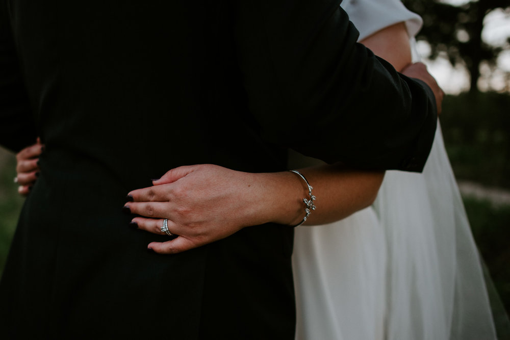 bride and groom embrace at texas wedding