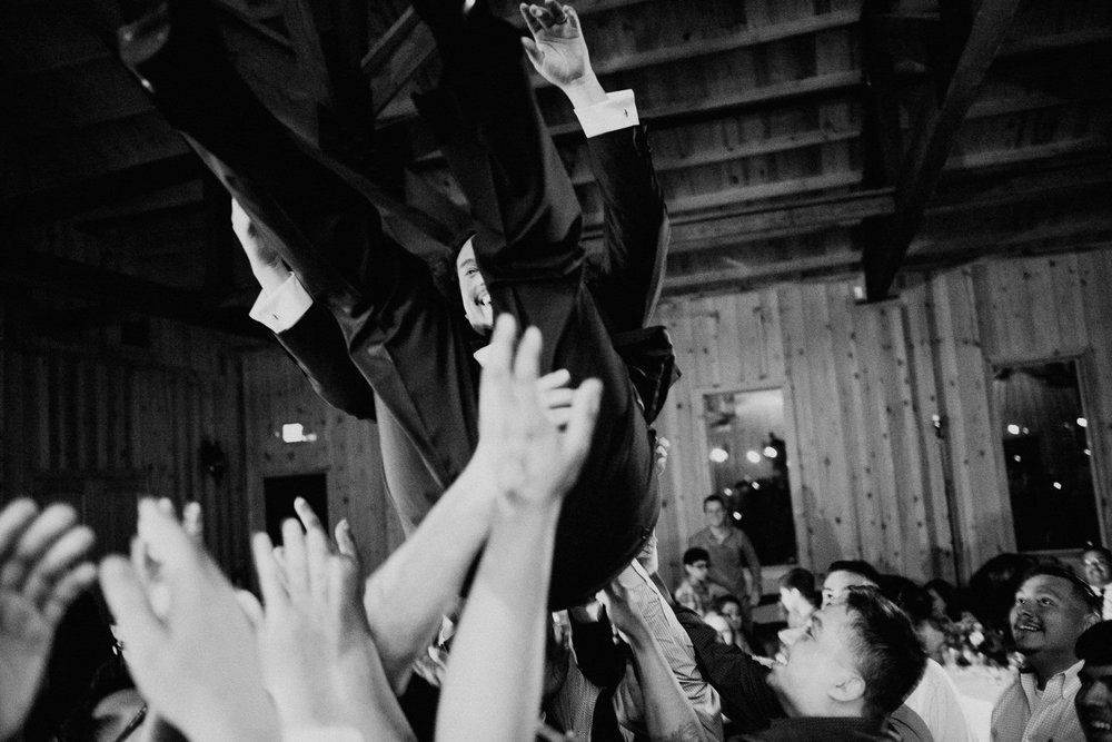 throwing the groom in the air at texas wedding reception