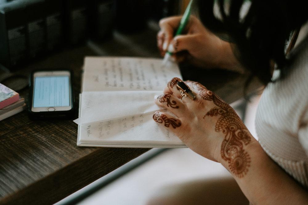 wedding vows being written in book
