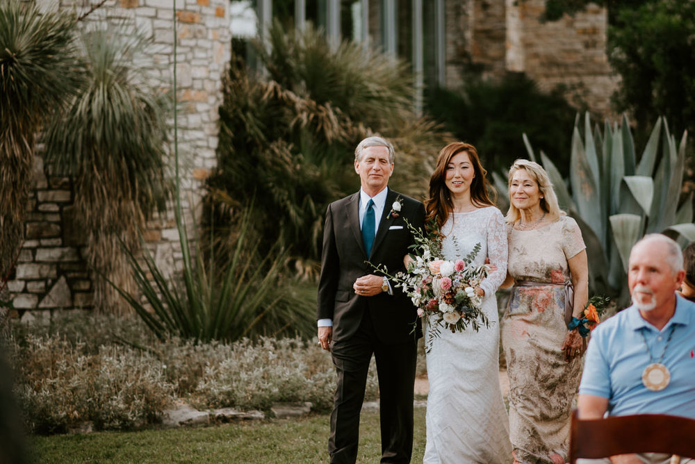bride walks down the aisle at austin texas wedding ceremony