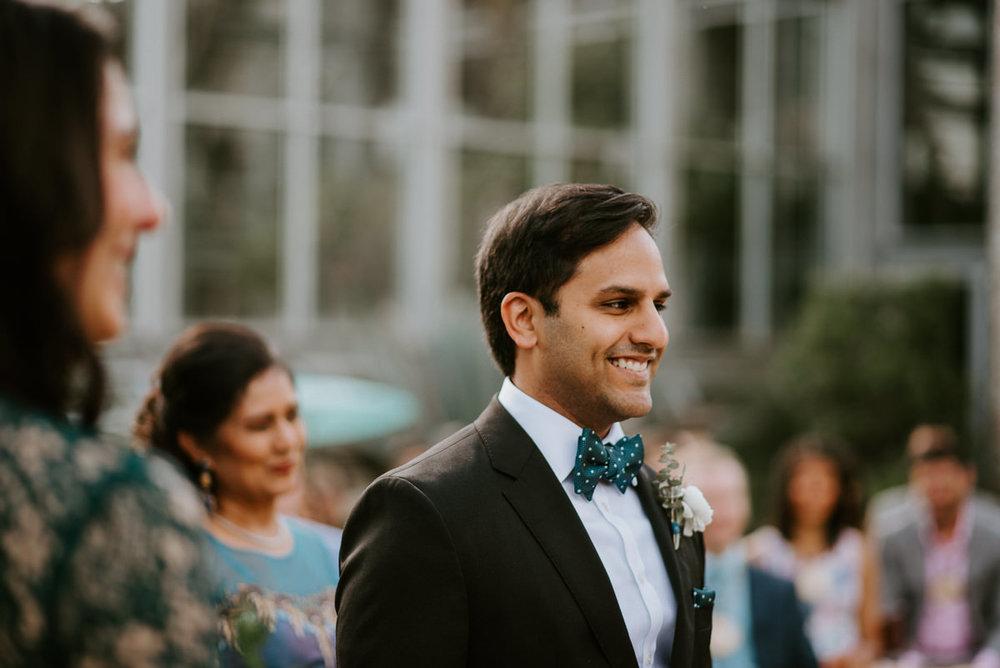 groom sees his bride walk down the aisle in austin wedding