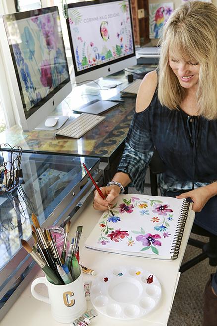 Corinne Haig painting in her art studio in Laguna Beach CA