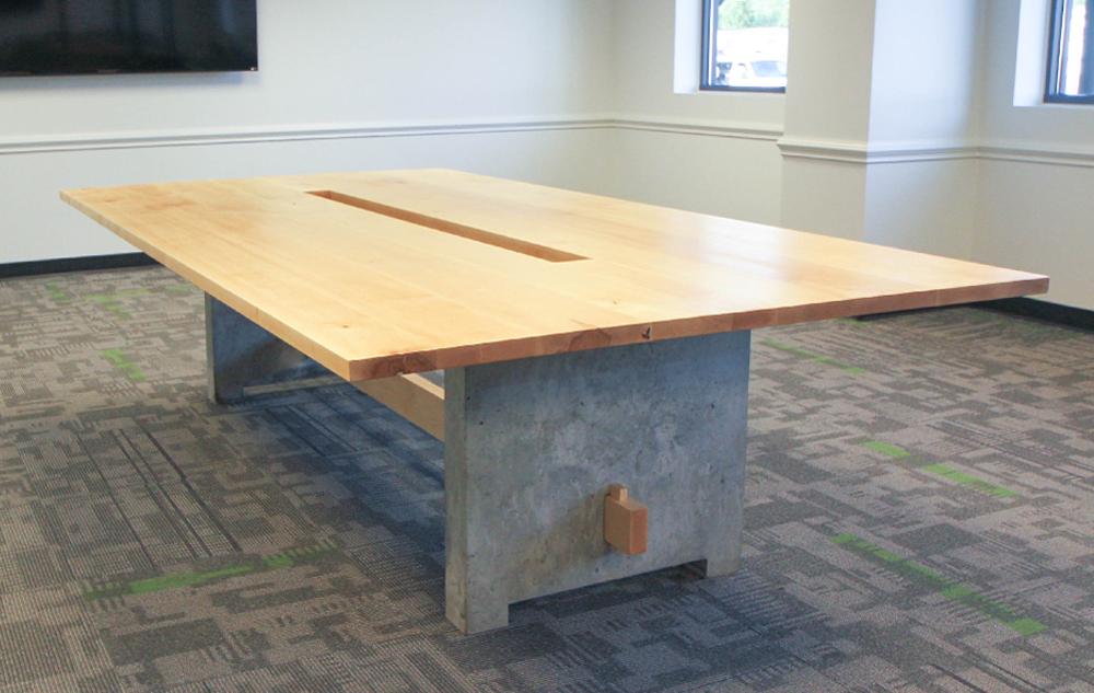 Over Sized Trestle Conference Table In Maple And Concrete.