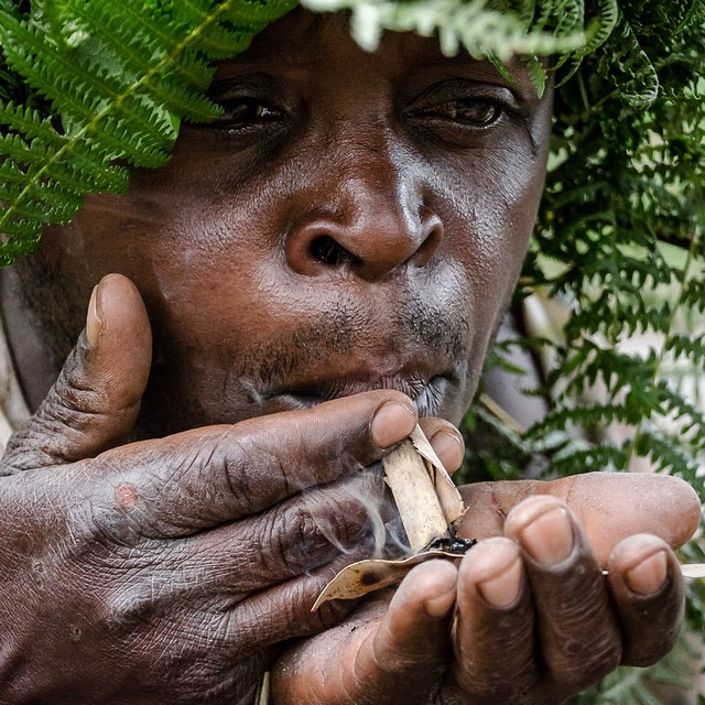 Member of the #Batwa #pygmy tribe, smoking a little homemade sumthin sumthin in #Bwindi Impenetrable Forest.