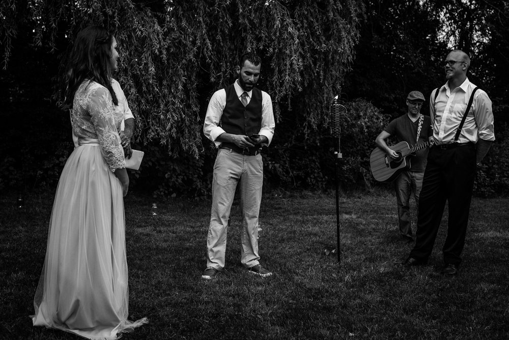 Groom serenading his wife while his brother plays guitar