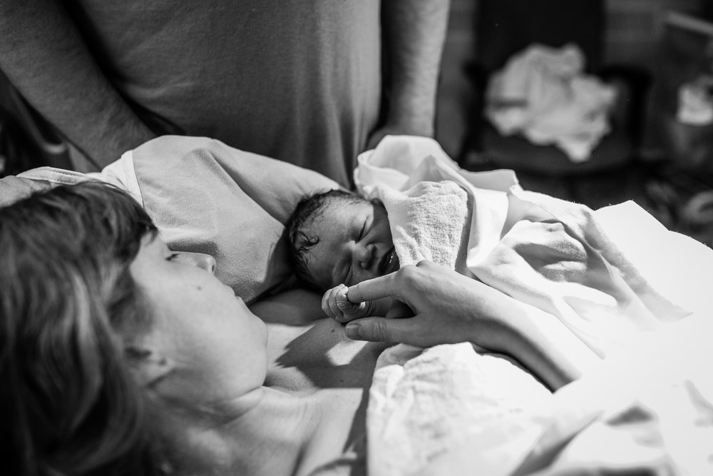 newborn in mothers arms.jpg