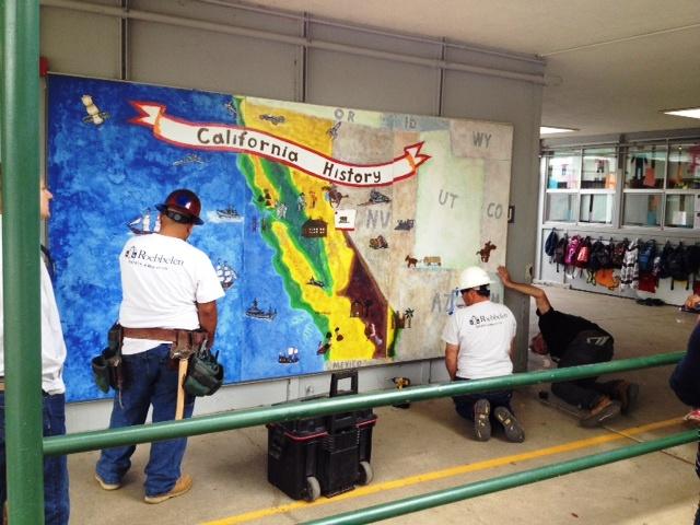 installing the mural.JPG