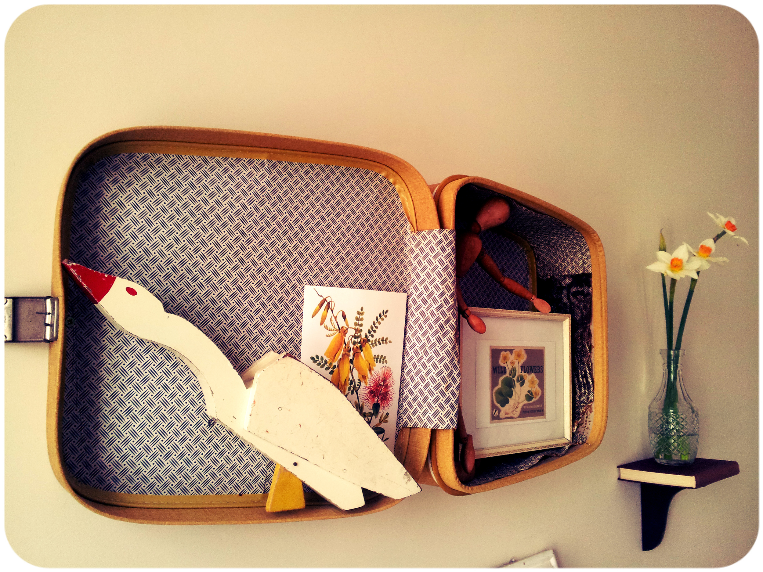 It's a vintage suitcase, er, stuck on the wall, y'know?