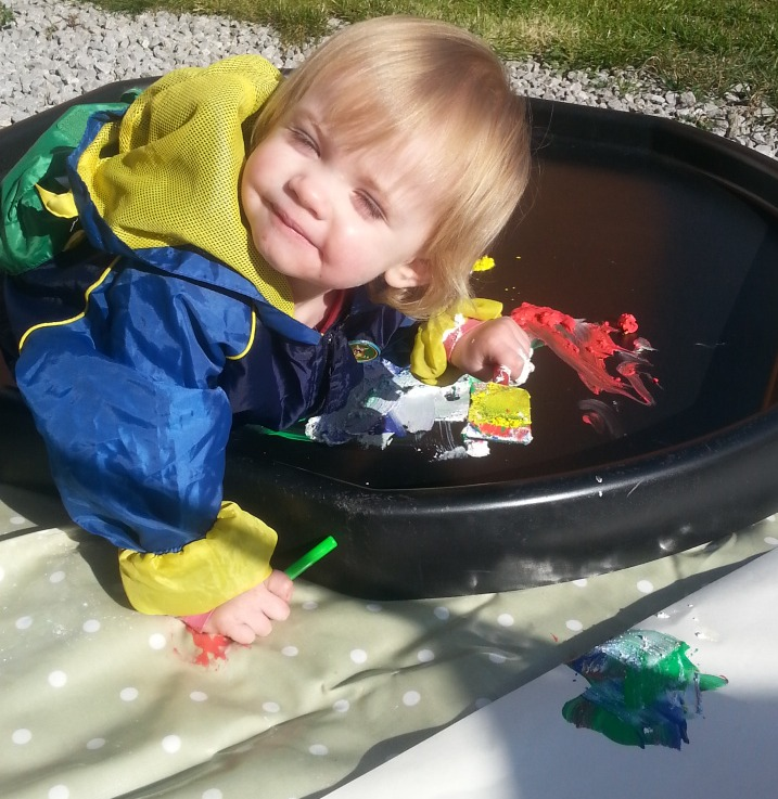 Little Miss A gets really messy with outdoor painting!