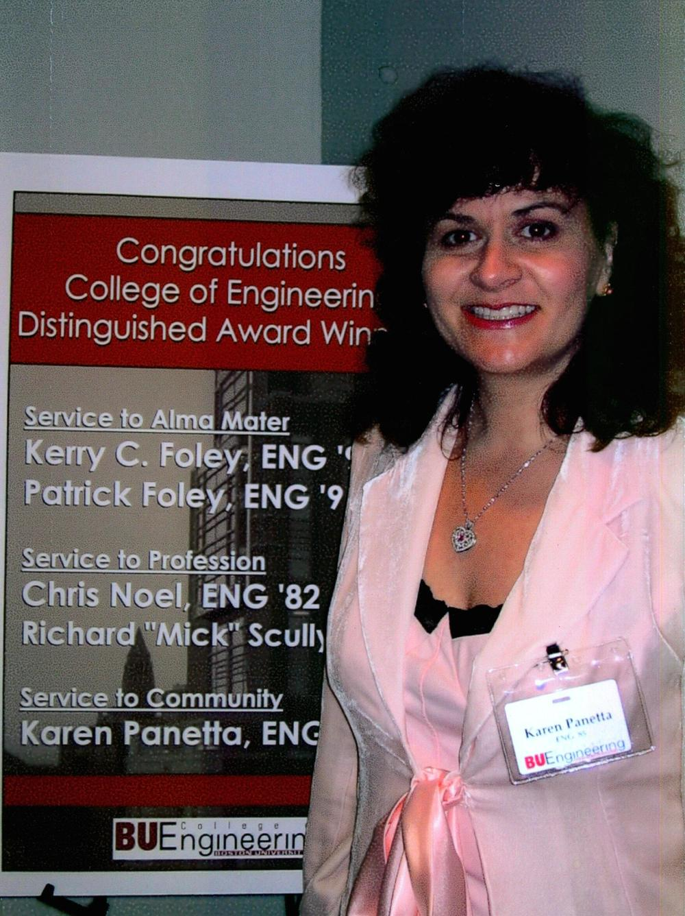 Karen getting her alumni award from Boston University