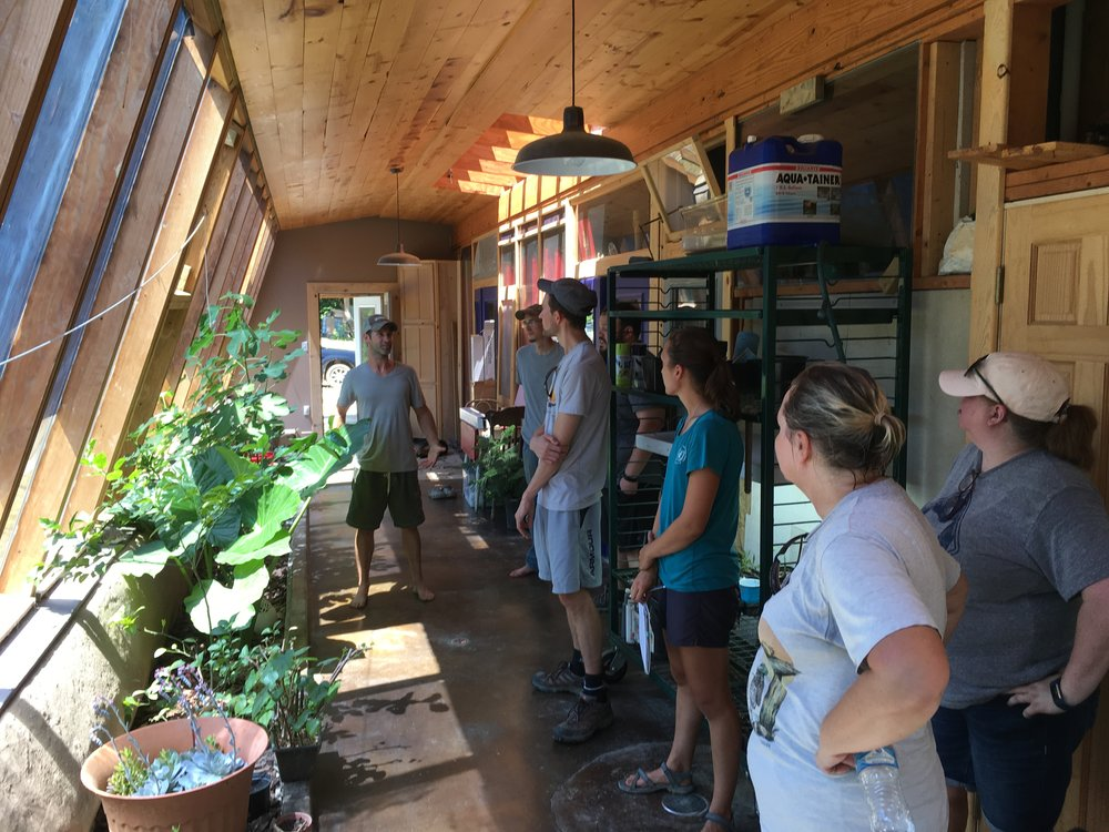 Our 2017/18 Class learning about Passive Solar, Off Grid Construction in an off-grid house built by a former student.