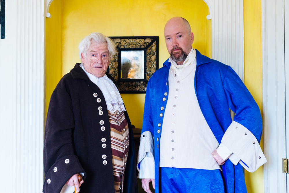 Tony Rivenbark as Benjamin Franklin and Jason Hatfield as John Dickinson, both delegates from Pennsylvania.  Photographed in the Burgwin Wright House.