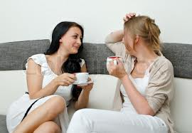 women with tea on couch talking.jpg