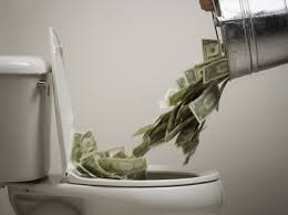 throw money down the toilet.jpg