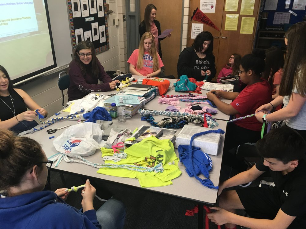 Students from Antioch Middle School create chew toys for local animal shelters.