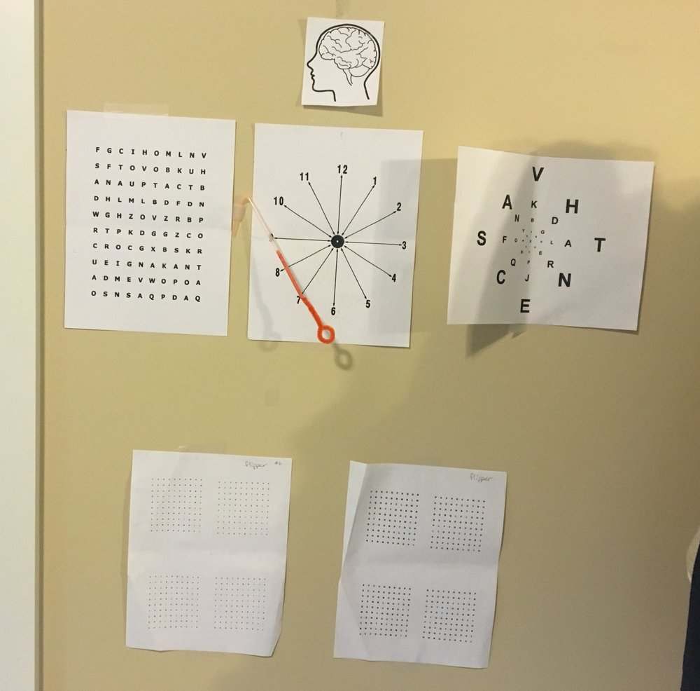 This is a wall in my room with some of my vision therapy exercises.