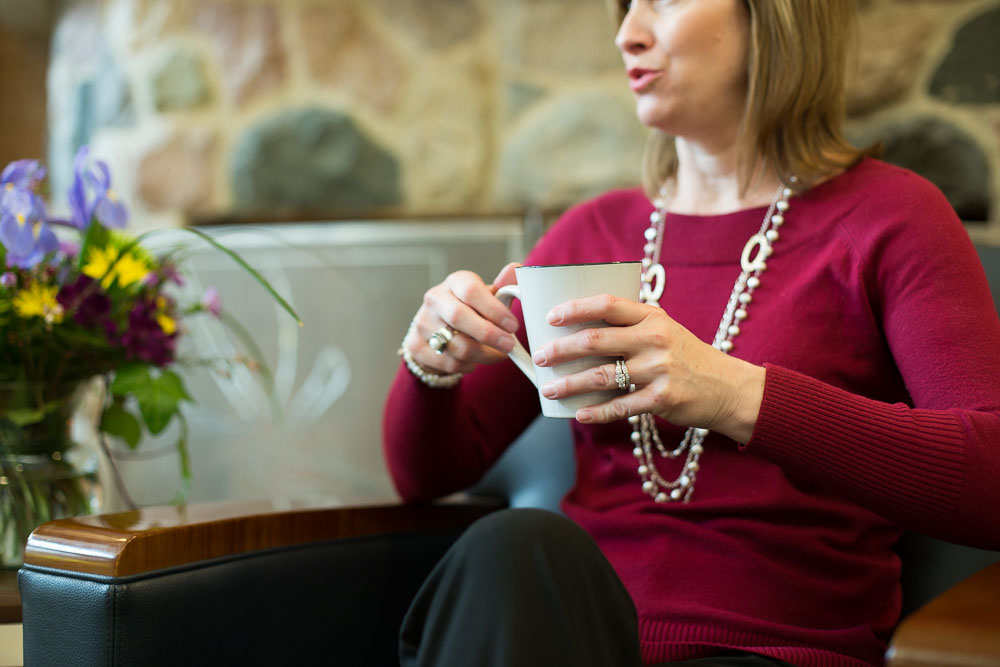 woman talking with coffee